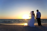 Married Couple Sunset Picture on the Beach
